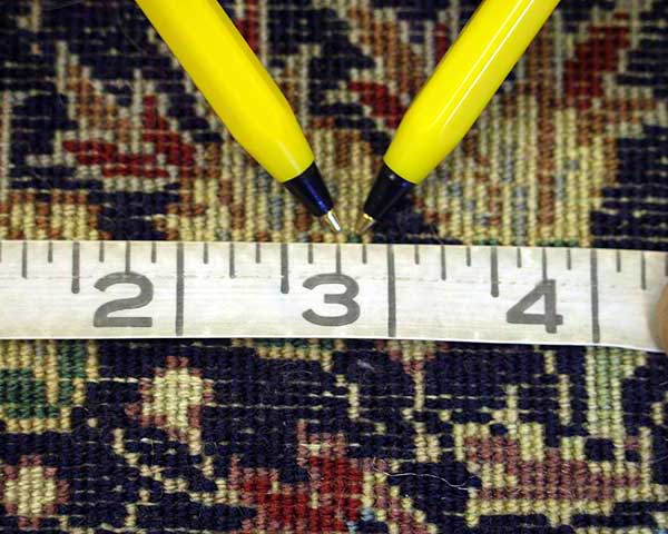 Senneh Knot Rug Measuring Tape On Horizontal Axis